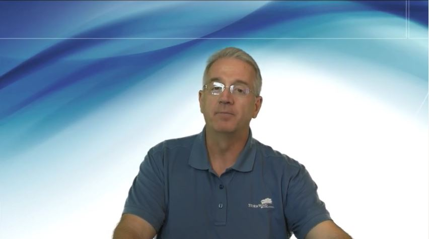 old man in front of blue screen